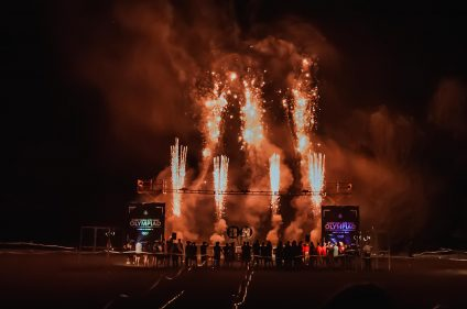 Fireworks against a night sky and podium